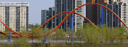 Roller coaster & buildings. Longueuil, Canada, view from Montreal. Recreation vs urban life royalty free stock photos