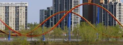 Roller coaster & buildings royalty free stock photos