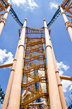 Roller coaster central view against summer sky Stock Image