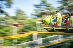 Roller coaster de Caterpillar en funpark Fotos de archivo libres de regalías