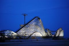 Roller coaster at dusk stock photos