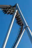Roller-coaster. Extrim moving roller coaster with blue sky royalty free stock photos