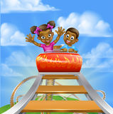 Roller Coaster Fair Theme Park. Cartoon boy and girl kids riding on a roller coaster ride at a theme park or amusement park Royalty Free Stock Photo