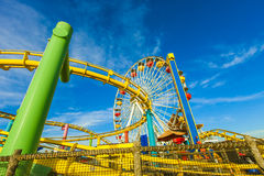 Roller Coaster and Ferris Wheel at Pacific Park on the Pier. The Santa Monica Pier is a large double-jointed pier located at the foot of Colorado Avenue in Santa Royalty Free Stock Photography