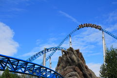 Roller coaster high-speed ride in banked turn Stock Photos