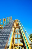 Roller coaster initial ramp with clear sky. Roller coaster initial ramp with a clear blue sky Stock Photography