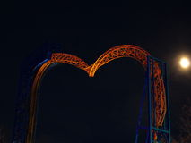 Roller coaster inverted tracks illuminated by night Stock Photos