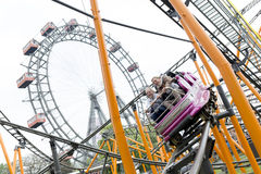 Roller coaster and large ferris wheel Prater Vienna Stock Image