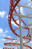 Roller coaster lines in blue sky Royalty Free Stock Photo