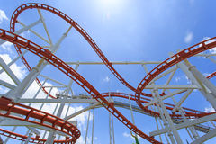 Roller coaster lines in blue sky Stock Image