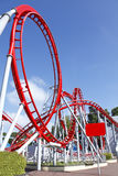 Roller coaster loop. Red roller coaster loop ride at funfair theme park Stock Photos