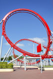 Roller coaster loop. Red roller coaster loop ride at fairground theme park Royalty Free Stock Photos