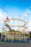 Roller coaster na noite contra o céu azul Imagens de Stock Royalty Free