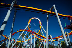 Roller coaster. Panoramic of a red and yellow roller coaster during a sunny day with clear sky Royalty Free Stock Image