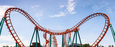 Roller Coaster, rail way curve and spin heart shape as panorama. Background royalty free stock image