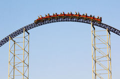 Roller coaster ride. Against blue sky Royalty Free Stock Photography
