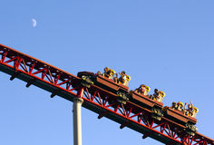 Roller coaster ride. Against blue sky with copyspace Stock Images