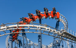 Roller coaster ride in Luna Park. Roller coaster ride under blue sky in Luna Park royalty free stock photography