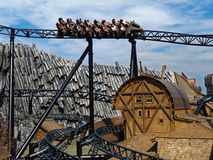 Roller coaster ride Taron in themed world Klugheim. Themed world Klugheim in Phantasialand, Germany  -  a craggy landscape with rustic houses - where the Royalty Free Stock Photo