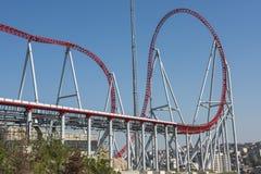 Roller coaster ride at a theme park Stock Photo