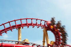 Roller coaster ride under blue sky stock image