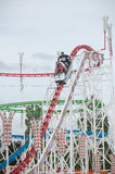 Roller coaster with shouting people in attraction park in Mulhouse. MULHOUSE - France - 23 July 2017 - roller coaster with shouting people in attraction park in Royalty Free Stock Images