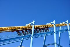 The roller coaster is starting on a sunny day.  stock photo