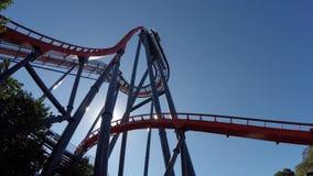 Roller coaster and sun glare stock video