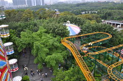 Roller coaster tunnel. A roller coaster in the amusement park in zhongshan park of tunnel and green trees and a cable car beautiful picture Stock Photos