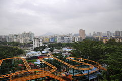 Roller coaster tunnel. And the foreground of the high-rise buildings formed a perfect curve Stock Photo