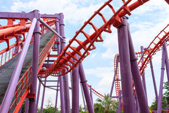Roller coaster twisting rail track in the amusement park. Roller coaster twisting rail track structure in the amusement park Stock Photo
