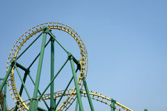 Roller coaster. Under blue sky royalty free stock image