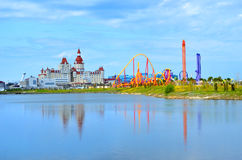 Roller coasters at the amusement park SochiPark and the Bogatyr hotel. Royalty Free Stock Photography