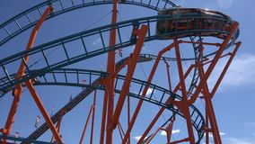 Roller Coasters, Rides, Amusement Parks. Stock video of roller coasters stock footage
