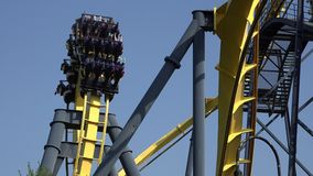 Roller Coasters, Rides, Amusement Parks. Stock video of a roller coaster stock video footage