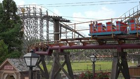 Roller Coasters, Rides, Amusement Parks. Stock video of a roller coaster (train stock footage