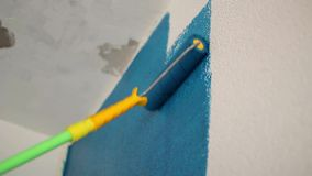 Roller color white wallpaper in dark blue stock video