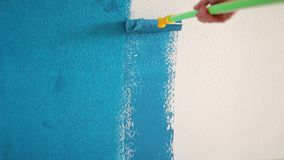 Roller color white wallpaper in dark blue stock footage