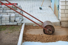 Roller compaction of soil. At the construction site Stock Photos