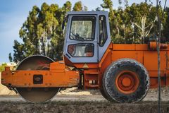 Roller compactor in a construction stock photos