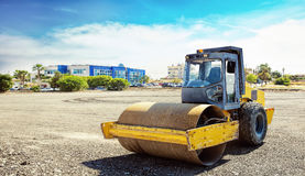 Roller compactor machine flattens the asphalt Royalty Free Stock Images