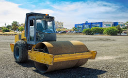 Roller compactor machine flattens the asphalt Royalty Free Stock Image
