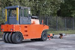 Roller compactor machine for pressing new asphalt royalty free stock photography