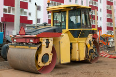 Roller at construction site next to new building at summer Royalty Free Stock Image