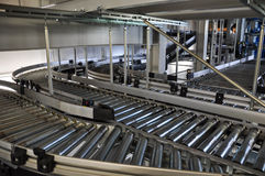 Roller conveyor in an automated warehouse Stock Photos