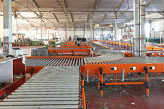 Roller conveyor. The interior of regional delivery hub warehouse Stock Photos
