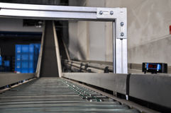 Roller conveyor with laser distance sensor. Stock Image