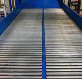 Roller conveyor for transporting crates Stock Image