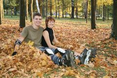 Roller couple sit in park Stock Photo