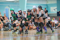 Roller derby. One of the fastest growing sports for women all across the globe Stock Photos